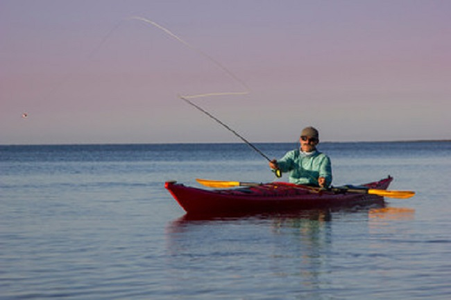 Man fly fishing from kayak in the Florida Everglades National Park
