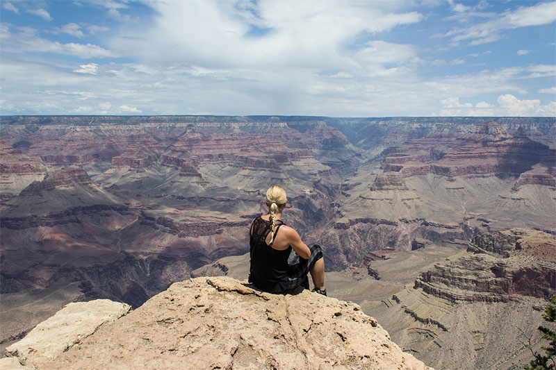 woman overlooking Grand Canyon