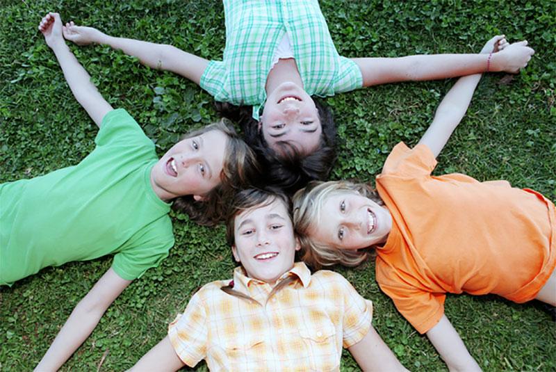 children lying on grass, Calaveras State Park