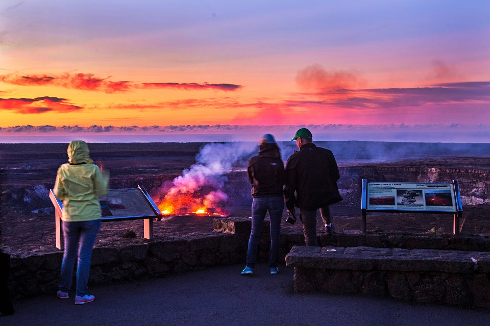 Tourists watch the eruption of Hawaii's Kīlauea from the observation deck at sunset