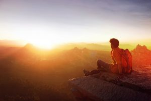 man looking out at horizon outdoors