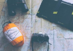 Hiking Gear including the Best Sleeping Bag, Binoculars, Camera, and Laptop